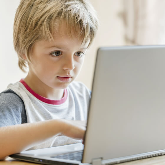 young-boy-working-on-laptop